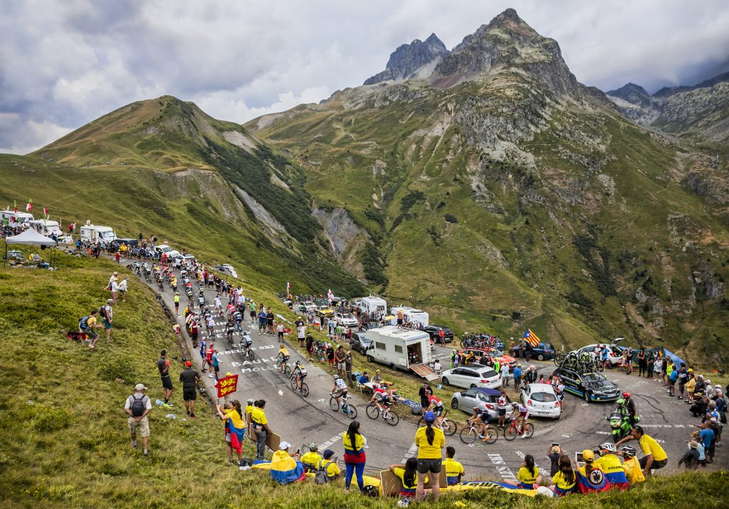 COL DU GLANDON, FRANCE - JUL 24: The peloton riding in a beautiful curve at Col du Glandon in Alps during the stage 19 of Le Tour de France on July 24, 2015.